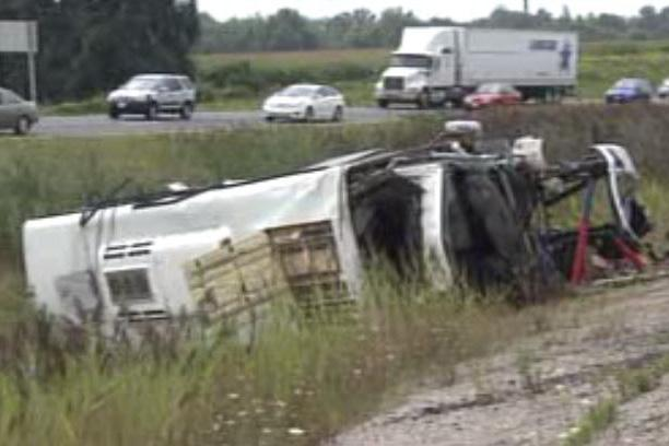Woman dead, 12 people in hospital after bus rollover on Highway 401