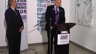 George Smitherman talking to reporters