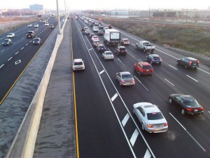 Drivers eastbound on the Queen Elizabeth Way at Third Line bypass heavy traffic using the new HOV lanes