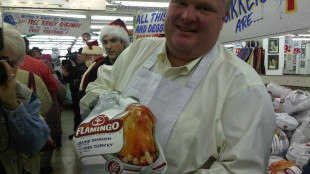Mayor Rob Ford hands out free turkeys at Honest Ed's