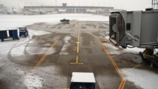 A stock photo showing an airport tarmac affected by snow. Several flights to and from Pearson International Airport from the US East Coast were cancelled Saturday.