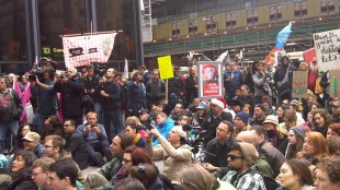 Toronto's financial district, King St and Bay St, fill with protestors for Occupy Toronto rally.