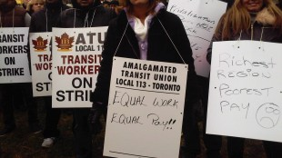 """Some York Region Transit protestors carried signs that read, """"richest region, poorest pay"""""""