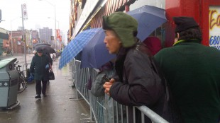 Saturday, December 4, 2011 - People line up outside Honest Ed's