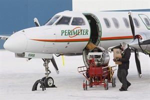 A crew member loads a Fairchild Metro 3/23 twin engine turbo prop at the Perimeter Aviation hangar in Winnipeg, Sunday, December 23, 2012. THE CANADIAN PRESS/John Woods