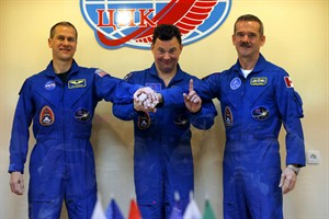 U.S. astronaut Thomas Marshburn, left, Russian cosmonaut Roman Romanenko, center, and Canadian astronaut Chris Hadfield, members of the next mission to the International Space Station, pose for the media after a news conference in the Russian leased Baikonur cosmodrome, Kazakhstan, Tuesday, Dec. 18, 2012. Hadfield is set to blast off today from the Baikonur Cosmodrome in Kazakhstan on a mission that is to see him become the first Canadian to command the International Space Station. THE CANADIAN PRESS/AP,Dmitry Lovetsky