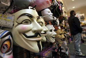 "FILE - In this Oct. 21, 2011 file photo, masks, including ""V for Vendetta,"" left, are displayed at a Ricky's Halloween store in New York. Television audiences across China watched an anarchist antihero rebel against a totalitarian government and persuade the people to rule themselves. Soon the Internet was crackling with quotes of ""V for Vendetta's"" famous line: ""People should not be afraid of their governments. Governments should be afraid of their people."" The airing of the movie Friday night, Dec. 14, 2012 on China Central Television stunned viewers and raised hopes that China is loosening censorship. (AP Photo/Richard Drew, File)"