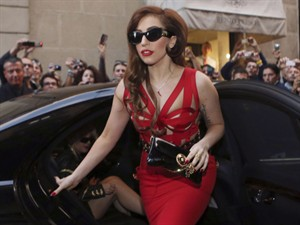 FILE - In this Monday, Oct. 1, 2012 file photo, Lady Gaga arrives at the Versace atelier in Milan, Italy. Lady Gaga is taking her Born This Way Foundation on the road. The singer announced Thursday, Dec. 20, 2012, that the Born Brave Bus Tour will tailgate outside her upcoming U.S. concerts and provide a space for 13- to 25-year-olds to learn more about local resources on anti-bullying, suicide prevention and mental health services. Her foundation focuses on youth empowerment and self-confidence. (AP Photo/Luca Bruno)