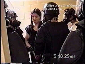 Ashley Smith is shown surrounded by guards at Joliette Institution in Joliette, Que., on July 26, 2007 in this image made from video. More than five years after a deeply disturbed teenager suffocated in her segregation cell, an inquest into her death that has already produced shocking surveillance videos is at last set to begin hearing evidence just weeks into the new year. THE CANADIAN PRESS/HO - Office of the Chief Coroner for Ontario