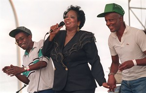 """In this Sept. 2, 1995 photo, Fontella Bass dances with Vernon Harris and Curtis Berry on the stage as she sings her 1965 hit """"Resuce Me"""" at the St. Louis Blues Heritage Festival. The St. Louis-born soul singer who hit the top of the R&B charts with """"Rescue Me"""" in 1965, died Wednesday, Dec. 26, 2012, of complications from a heart attack suffered three weeks ago. She was 72. (AP Photo/St. Louis Post-Dispatch, Odell Mitchell Jr.) EDWARDSVILLE INTELLIGENCER OUT; THE ALTON TELEGRAPH OUT"""
