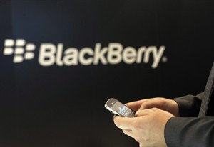 In this Nov. 8, 2011 photo, a Blackberry employee holds a mobile phone of Blackberry in Berlin. THE CANADIAN PRESS/AP, dapd, Berthold Stadler