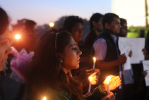 Indian students and activists carry candles at India Gate during a protest following the gang-rape of a student in New Delhi on Dec. 19, 2012