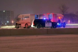 Ontario Provincial Police officers stood guard as money was transferred between two Brinks trucks, one which was involved in a crash.