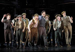 """FILE - In this theater image released by Disney Theatricals, the cast of The Paper Mill Playhouse Production of """"Newsies,"""" starring Jeremy Jordan, center right, is shown in New York. Disney Theatrical Productions said Thursday, Dec. 20, 2012, that the musical recouped its $5 million investment in just over nine months, faster than any Disney property. (AP Photo/Disney Theatricals, T. Charles Erickson, File)"""