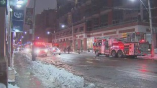 Emergency crews on the scene of a fatal fire in the downtown core.