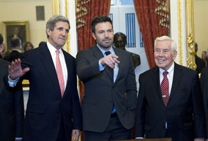 Sen. John Kerry D-Mass., shakes hands with actor Ben Affleck during a meeting with foreign relations members to discus the crisis in the Democratic Republic of Congo on Capitol Hill in Washington on Wednesday, Dec. 19, 2012. With them is Sen. Richard Lugar R-IN., right. (AP Photo/Jose Luis Magana)