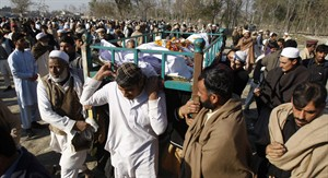 Pakistani villagers attend a funeral of health worker Hilal Khan, who was killed by gunmen, in Wahidgari, outskirts of Peshawar, Pakistan on Thursday, Dec. 20, 2012. Another victim from attacks on U.N.-backed anti-polio teams in Pakistan died on Thursday, bringing the three-day death toll in the wave of assaults on volunteers vaccinating children across the country to nine, officials said. (AP Photo/Mohammad Sajjad)