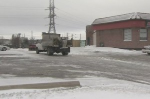 A man was trapped underneath a snowplow in this parking lot in Newmarket, police said.