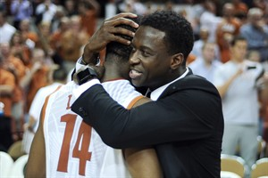 Texas guard Myck Kabongo, right, embraces Julien Lewis (14) after their 85-67 win over North Carolina in an NCAA college basketball game, Wednesday, Dec. 19, 2012, in Austin, Texas. Lewis scored 16 points in the victory. The NCAA is investigating Kabongo's relationship with an agent and Texas has given no indication when or if he'll return. (AP Photo/The Daily Texan, Lawrence Peart)