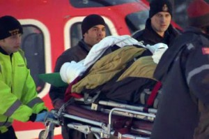 Emergency officials rush an injured York Regional Police officer to hospital.