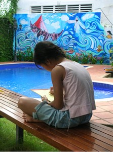 A young girl at a sanctuary for children rescued from a Cambodian brothels writes a letter of forgiveness to her mother, who knowingly sold her to be sexually abused, in a photo released by Ratanak International. THE CANADIAN PRESS/HO