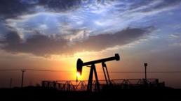 An oil pump operates in the desert oil fields of Sakhir, Bahrain, at sunset Oct. 29, 2012. THE CANADIAN PRESS/AP, Hasan Jamali