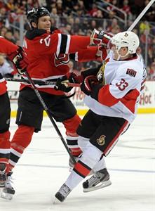 New Jersey Devils' David Clarkson, left, checks Ottawa Senators' Jakob Silfverberg, of Sweden, during the first period of an NHL hockey game Monday, Feb. 18, 2013, in Newark, N.J. (AP Photo/Bill Kostroun)