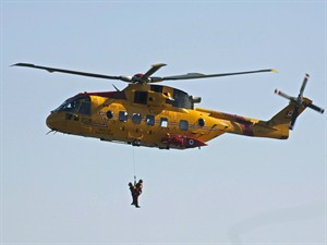 Search and rescue technicians are hoisted by a Cormorant helicopter during a Canada-United States coast guard ceremony in Halifax on Thursday, Sept. 28, 2006. A search was underway Monday for five halibut fishermen whose vessel sank off the southwest coast of Nova Scotia in 10-metre seas lashed by hurricane-force winds. THE CANADIAN PRESS/Andrew Vaughan