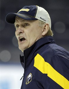 Buffalo Sabres coach Lindy Ruff talks with players during NHL hockey practice in Buffalo, N.Y. in this Jan. 11, 2012 photo. The Sabres have fired Ruff as a result of the team's inconsistent start to the season. THE CANADIAN PRESS/AP/David Duprey