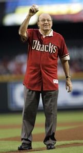 FILE - In this Oct. 11, 2007, file photo, Hall of Fame broadcaster Joe Garagiola throws out the ceremonial first pitch before Game 1 of the National League Championship baseball series between the Arizona Diamondbacks and Colorado Rockies in Phoenix. Garagiola, whose career transcended sports with his sharp sense of humor and limitless list of stories to tell, announced during a news conference on Wednesday, Feb. 20, 2013, that he is calling it quits as part-time television game analyst for the Diamondbacks. (AP Photo/Morry Gash, File)