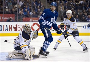 Buffalo Sabres defenceman Christian Ehrhoff (10) looks on as goaltender Ryan Miller makes a save under pressure from Toronto Maple Leafs left winger James van Riemsdyk (21) during second period NHL action in Toronto on Thursday February 21, 2013. THE CANADIAN PRESS/Frank Gunn