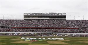 Drivers take the green flag at the start of the Daytona 500 NASCAR Sprint Cup Series auto race, Sunday, Feb. 24, 2013, at Daytona International Speedway in Daytona Beach, Fla. (AP Photo/Chris O'Meara)