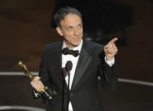 "Mychael Danna accepts the award for best original score for ""Life of Pi"" during the Oscars at the Dolby Theatre on Sunday Feb. 24, 2013, in Los Angeles. (Photo by Chris Pizzello/Invision/AP)"