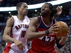 Toronto Raptors guard DeMar DeRozan (10) guards Washinton Wizards centre Nene (42) during second half NBA action in Toronto on Monday February 25, 2013. THE CANADIAN PRESS/Frank Gunn