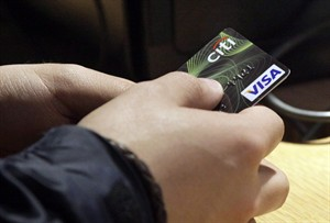 A Visa credit card is used at opening of the Superdry store in New York's Times Square in this May 9, 2012 file photo,. THE CANADIAN PRESS/AP/Richard Drew