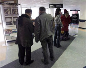 People line up at the Resource Canada offices in Montreal on April 9, 2009. THE CANADIAN PRESS/Ryan Remiorz