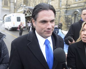 Sen. Patrick Brazeau talks to media on Parliament Hill in Ottawa, Tuesday, Feb.12, 2013. Brazeau has formally entered a not guilty plea to charges of assault and sexual assault.THE CANADIAN PRESS/Adrian Wyld