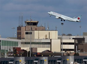 An Air Canada passenger jet takes off over the terminal at Halifax Stanfield International Airport on Jan. 21, 2013. . THE CANADIAN PRESS/Andrew Vaughan