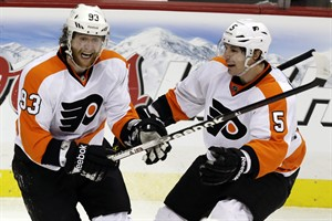 Philadelphia Flyers right wing Jakub Voracek (93) celebrates with defenseman Braydon Coburn (5) after scoring the winning goal late in the third period of an NHL hockey game against the Pittsburgh Penguins in Pittsburgh, Wednesday, Feb. 20, 2013. The Flyers won 6-5. (AP Photo/Gene J. Puskar)