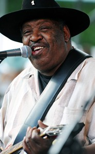 """FILE - In this July 5, 2009 file photo, Bluesman Magic Slim performs with his band """"The Teardrops"""" on the final day of the Waterfront Blues Festival in Portland, Ore. Slim, a contemporary of blues greats Muddy Waters and Howlin' Wolf who helped shape the sound of the Chicago blues, died Thursday, Feb. 21, 2013. He was 75.(AP Photo/Greg Wahl-Stephens, File)"""
