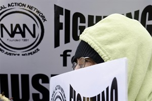 Elizabeth Taylor, 70, of Flint, holds a sign asking for racial justice outside Hurley Medical Center in Flint, Mich. on Tuesday, Feb. 19, 2013, during a protest in response to an African-American nurse's claim that the hospital agreed to a man's request that no black nurses care for his newborn. (AP Photo/The Flint Journal, Lauren Justice) LOCAL TV OUT; LOCAL INTERNET OUT