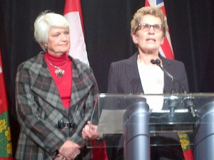 Premier Kathleen Wynne (right) with Education Minister Liz Sandals react to the resturn of extra-curricular activities in Ontario public high schools, Friday February 22, 2013.