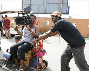 "Director Sudz Sutherland (right) on the set of ""Home Again."" THE CANADIAN PRESS/ho-eOne Films"