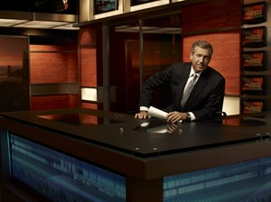 """This 2009 photo released by NBC shows Brian Williams on the set of """"Nightly News with Brian Williams,"""" in New York. ABC, CBS, NBC evening newscasts had 11 percent fewer viewers because of the time change and longer days. The Nielsen company says the newscasts collectively had 11 percent fewer viewers last week than they did the week before. (AP Photo/NBC News, Justin Stephens)"""