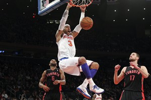 New York Knicks' Kenyon Martin (3) dunks as Toronto Raptors' Jonas Valanciunas (17) and Alan Anderson watch during the first half of an NBA basketball game, Saturday, March 23, 2013, at Madison Square Garden in New York. (AP Photo/Mary Altaffer)