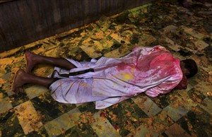 A Hindu devotee prostrates amid colors thrown inside Banke Bihari temple as he prays during Holi festival celebrations in Vrindavan, India, Monday, March 25, 2013. Holi, the festival of colors celebrates the arrival of spring among other things. (AP Photo/Altaf Qadri)