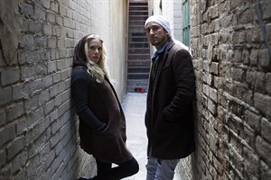 """Sarah Blackwood and Gianni Luminati from Walk off the Earth pose for a photo as they promote their new album """"R.E.V.O."""" in Toronto on Tuesday, March 5, 2013. THE CANADIAN PRESS/Chris Young"""