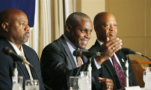 """U.S. Olympian Carl Lewis, center, speaks as fellow Olympians Mike Powell, left, and Willie Banks listen during a press conference in Tokyo, Monday, March 25, 2013. The former athletes discussed their participation in the """" Tohoku Sports Summit,"""" a campaign to support some 70 young Japanese athletes from the disaster-hit Tohoku area. (AP Photo/Koji Sasahara)"""