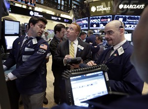 In this March 19. 2013 photo, specialist Joseph Dreyer, left, works with traders on the floor of the New York Stock Exchange. THE CANADIAN PRESS/AP, Richard Drew