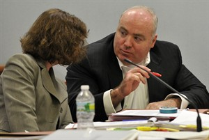 Michael Skakel, right, talks to Jessica Santos, one of his defense attorneys, at his habeas corpus hearing at Rockville Superior Court in Vernon, Conn., on Thursday, April 18, 2013. Skakel is serving 20 years to life for the 1975 golf club bludgeoning of Greenwich neighbor Martha Moxley when they were 15. His appeal argues that he was deprived of effective legal representation in his first trial. (AP Photo/Stamford Advocate, Jason Rearick, Pool)